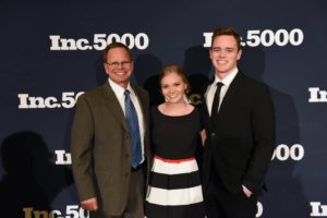 Cal Tingey as a speaker at the Inc 5000 Conference with his kids in attendance